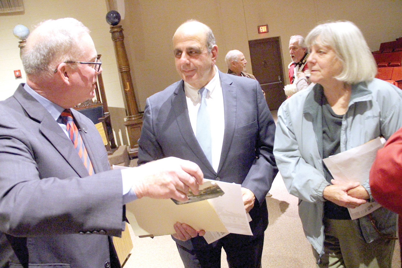 "ALL ABOUT THE BRIDGE: Rep. Joseph McNamara, Mayor Joseph Solomon and Ginny Leslie of the Pawtuxet Village Association talk at the conclusion of Tuesday's meeting over ""preservation"" of the village bridge."