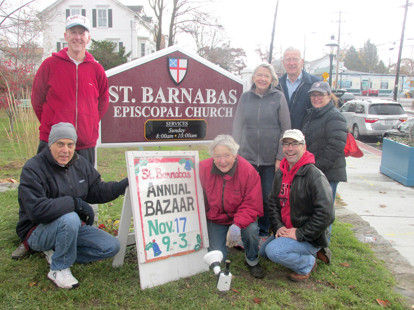 PROUD PARISHIONERS: Among the St. Barnabas Church family who have worked hard to present a great food and shopping experience during Saturday's annual Holiday Bazaar are: Stan Schofield, Eric Simonian, Tom Chadwick, Robin Beckwith, Bonnie Simonian, Diane Whitehead and Father Scott Lee.
