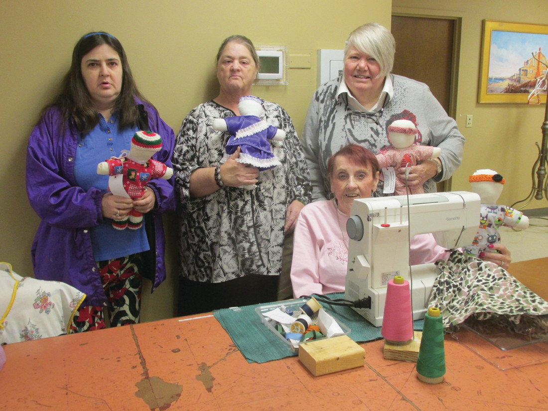SKILLED STAFF: Among those Cranston Senior Center volunteers who handmade 100 Smile dolls for the Alzheimer/Dementia Unit at the Briarcliffe Campus in Johnston are, from left: Felicia Lema, Rebecca Finney, Bina Gehres and Josephine Gemma.