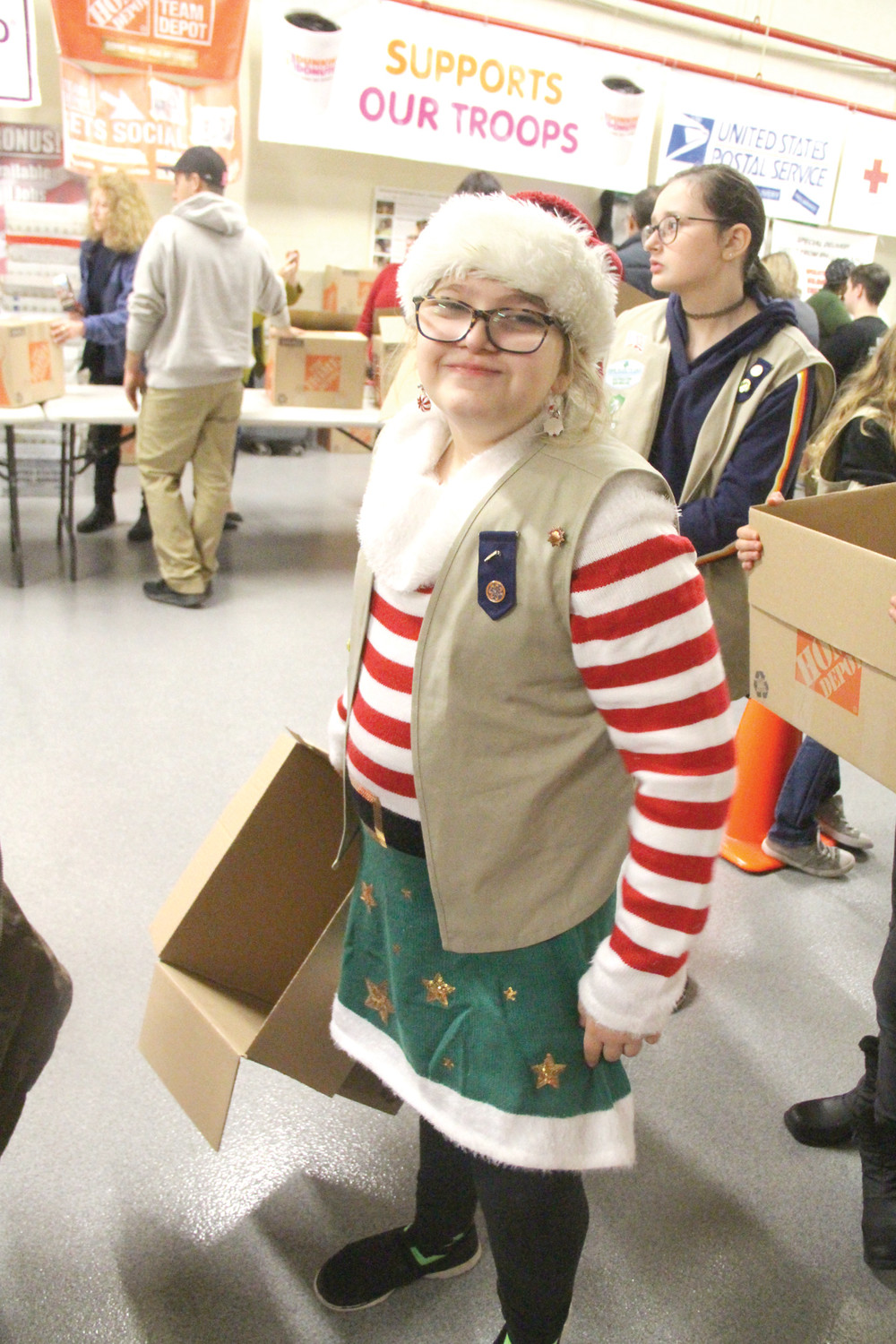 DRESSED FOR THE ROLE: Shannon Doyle, a member of Girl Scout Troop 922 of Smithfield, wore her Santa's helper outfit for the occasion.