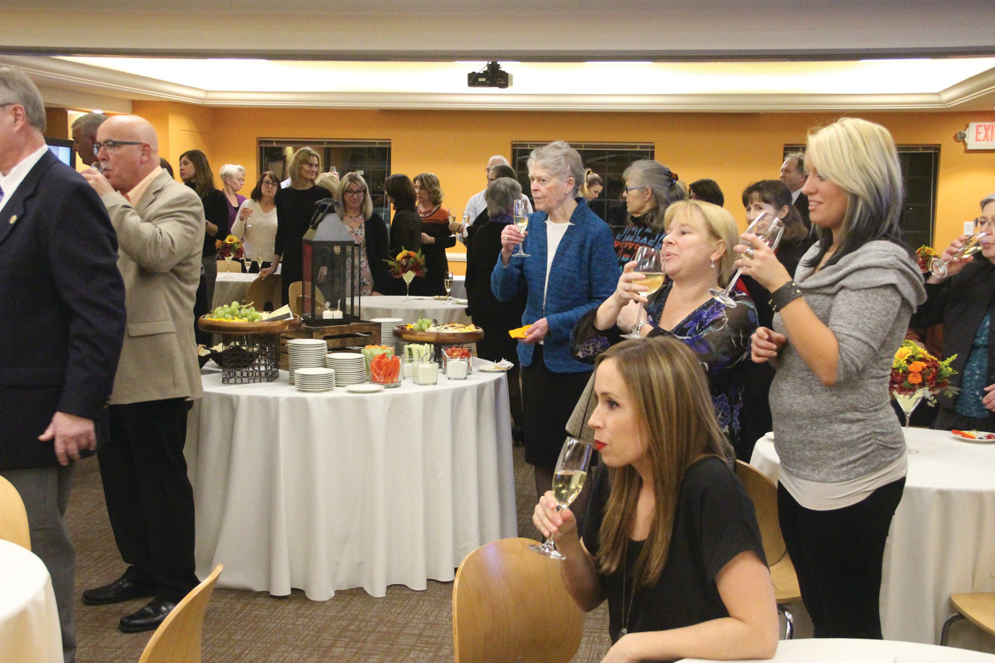 TOAST TO A CENTURY: Those joining in the Sargent Center celebration raised glasses to 101 years of work with disabled children and adults.