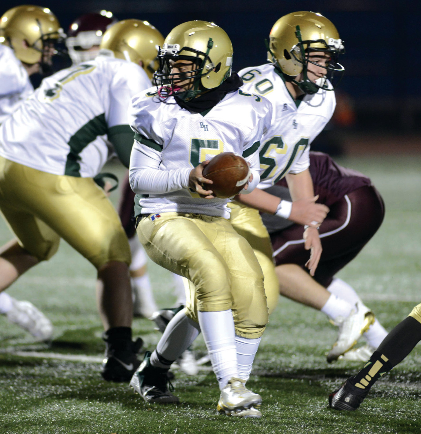 IN THE POCKET: Bishop Hendricken quarterback Sensere Fernandes hands the ball off. (Submitted photo)