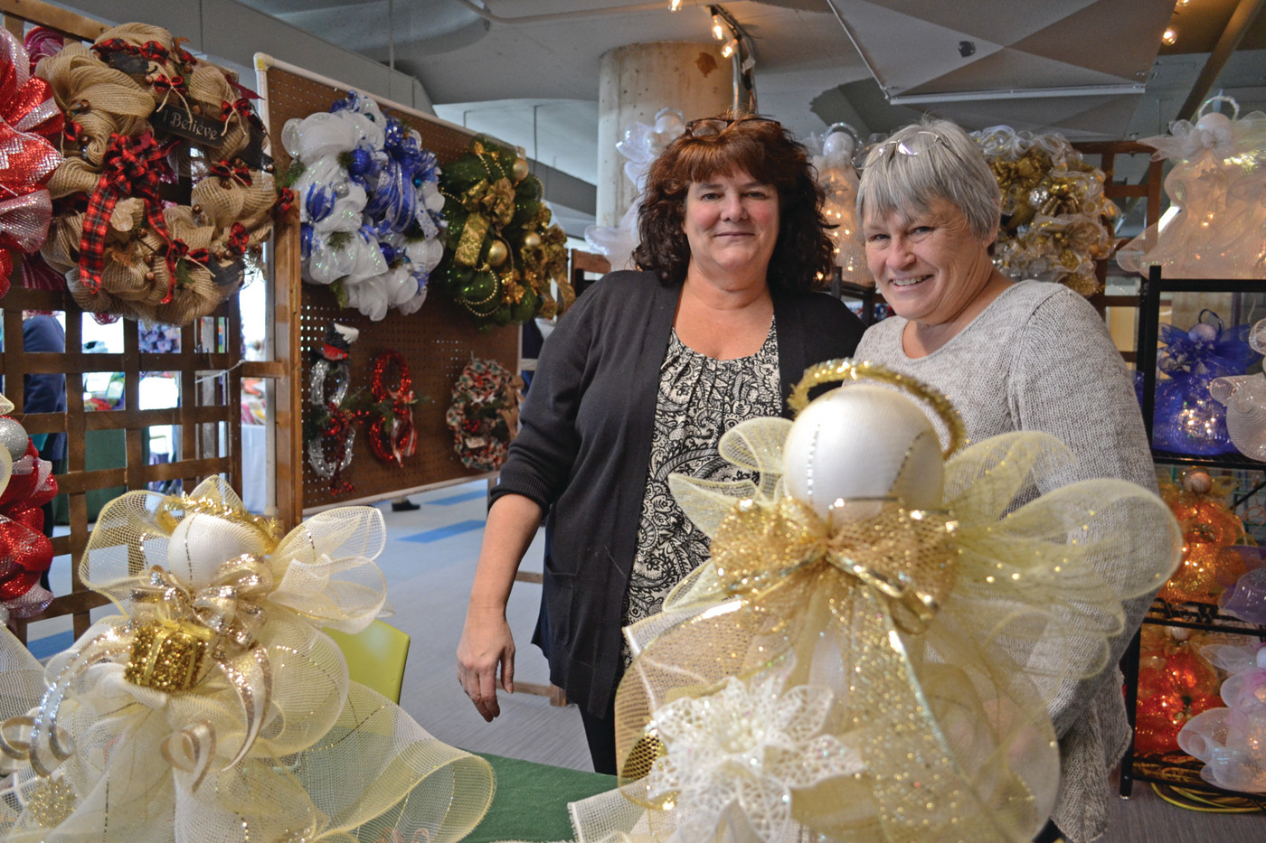 DOWNRIGHT ADORNABLE: Maureen King, purveyor of A Wreath 4 Every Season, and Deanna Mann were selling handmade wreaths at the CCRI Artisans Holiday Show on Friday.