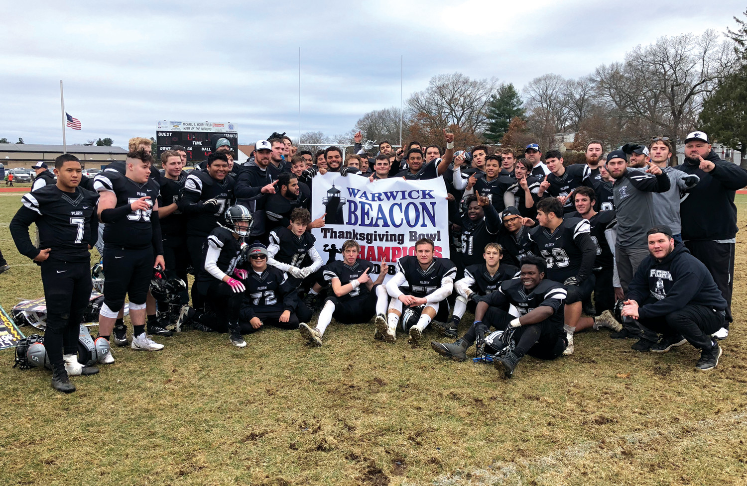 THIRD TIME'S A CHARM: The Pilgrim football team after capturing its first Warwick Beacon Bowl win.