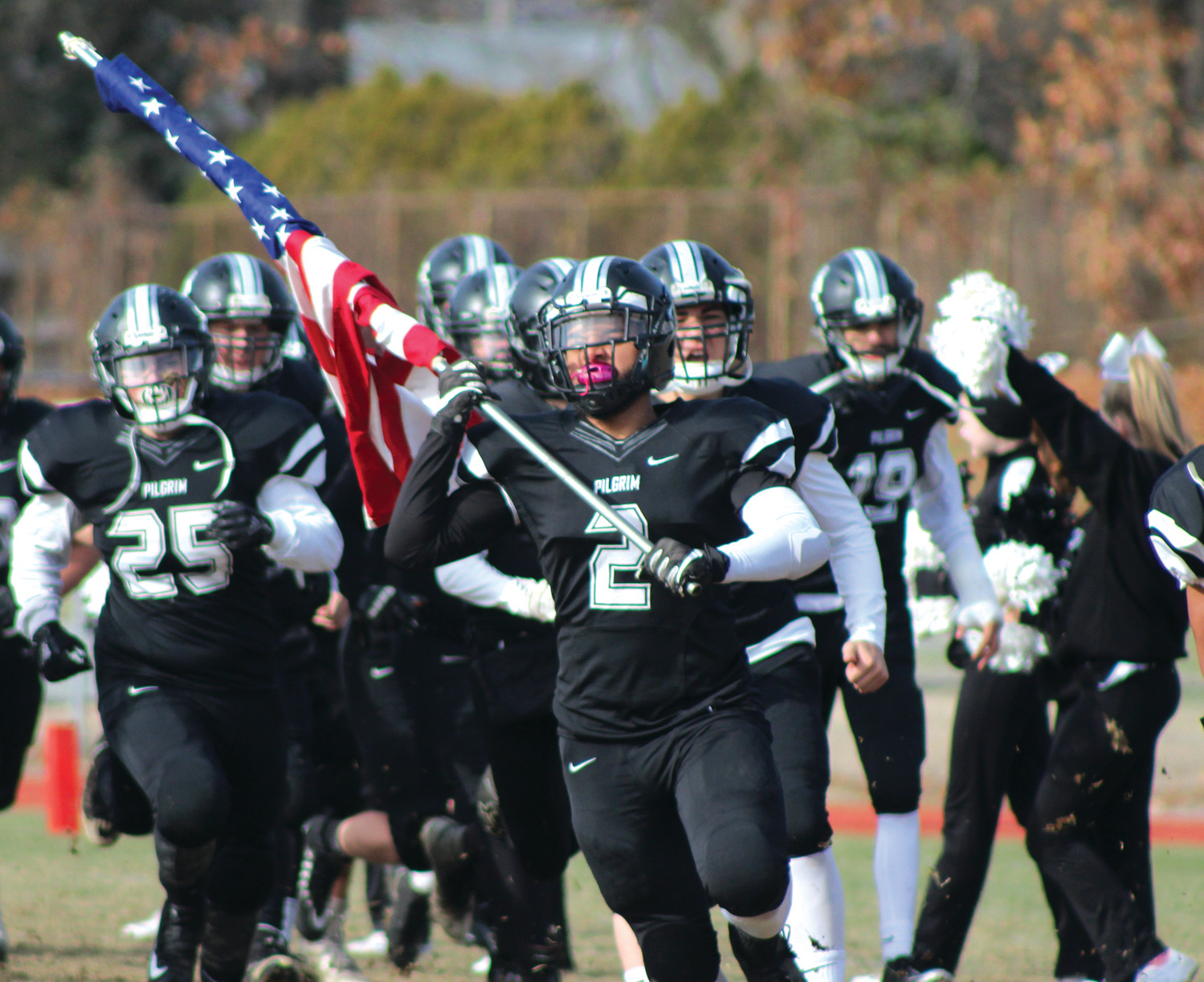 GRAND ENTERANCE: Pilgrim's Mark Brown (2) leads the team to the field prior to kickoff.