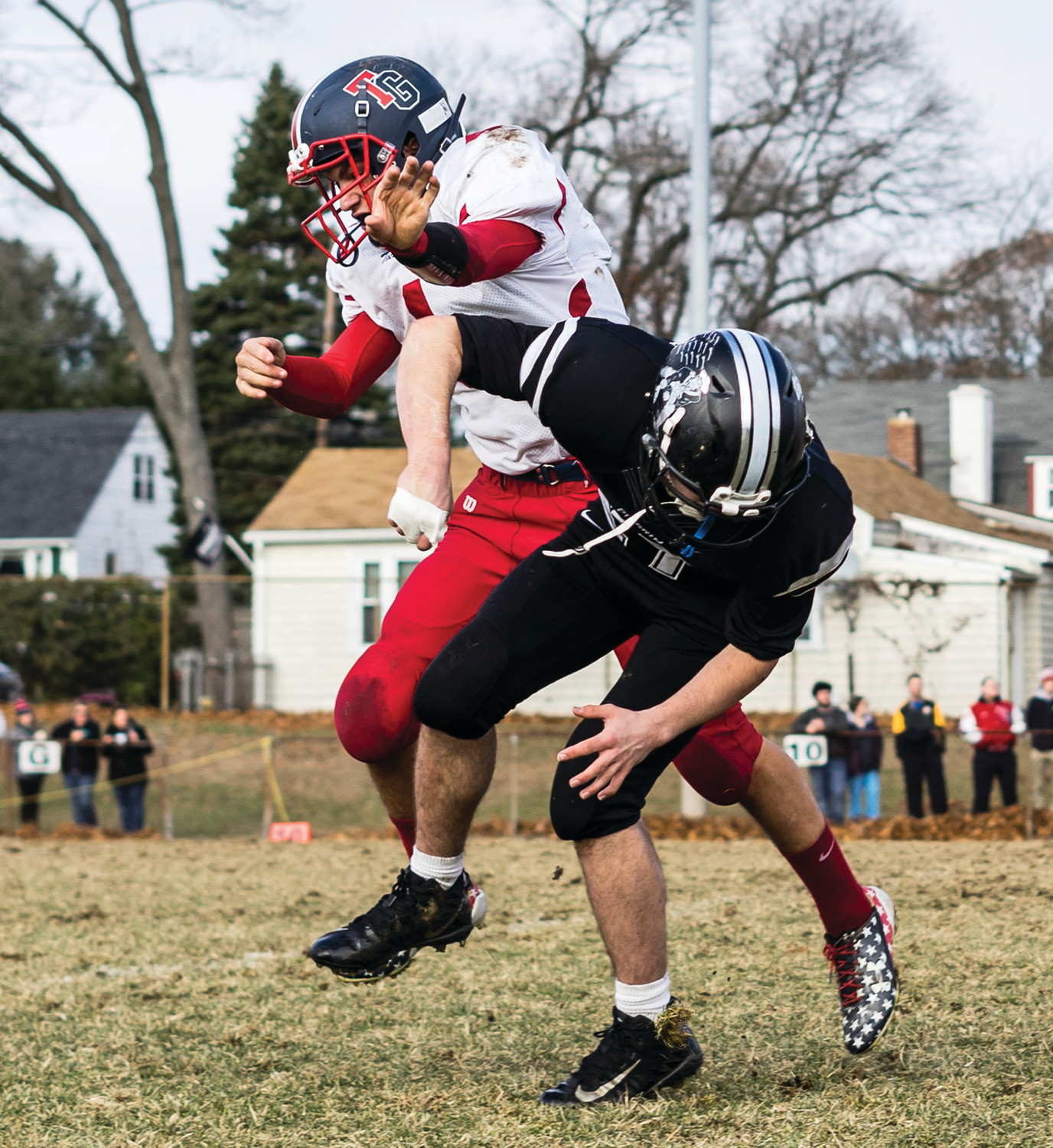 HEATED RIVALRY: Members of the Pilgrim and Toll Gate football teams do battle at the 2018 Warwick Beacon Bowl.