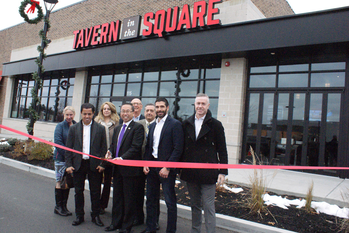 ON THE RIBBON: On Nov. 19, Mayor Allan Fung officially welcomed Tavern In The Square to the Cranston business community. Joining the Mayor were Janice Pascone (marketing director for Garden City Center), Renato Valentim (co-owner), Dina Campbell (Garden City Center), Joe Koechel (general manager for Garden City Center), Mike Favicchio (City Councilman Ward 6), Stephen DeSousa (co-owner) and Joey Arcari (co-owner).