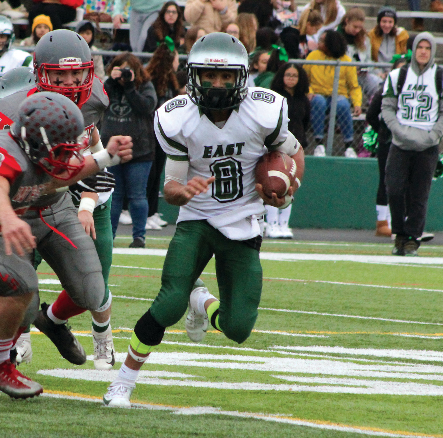 ON THE MOVE: Cranston East's Robenson Antoine picks up some yards.