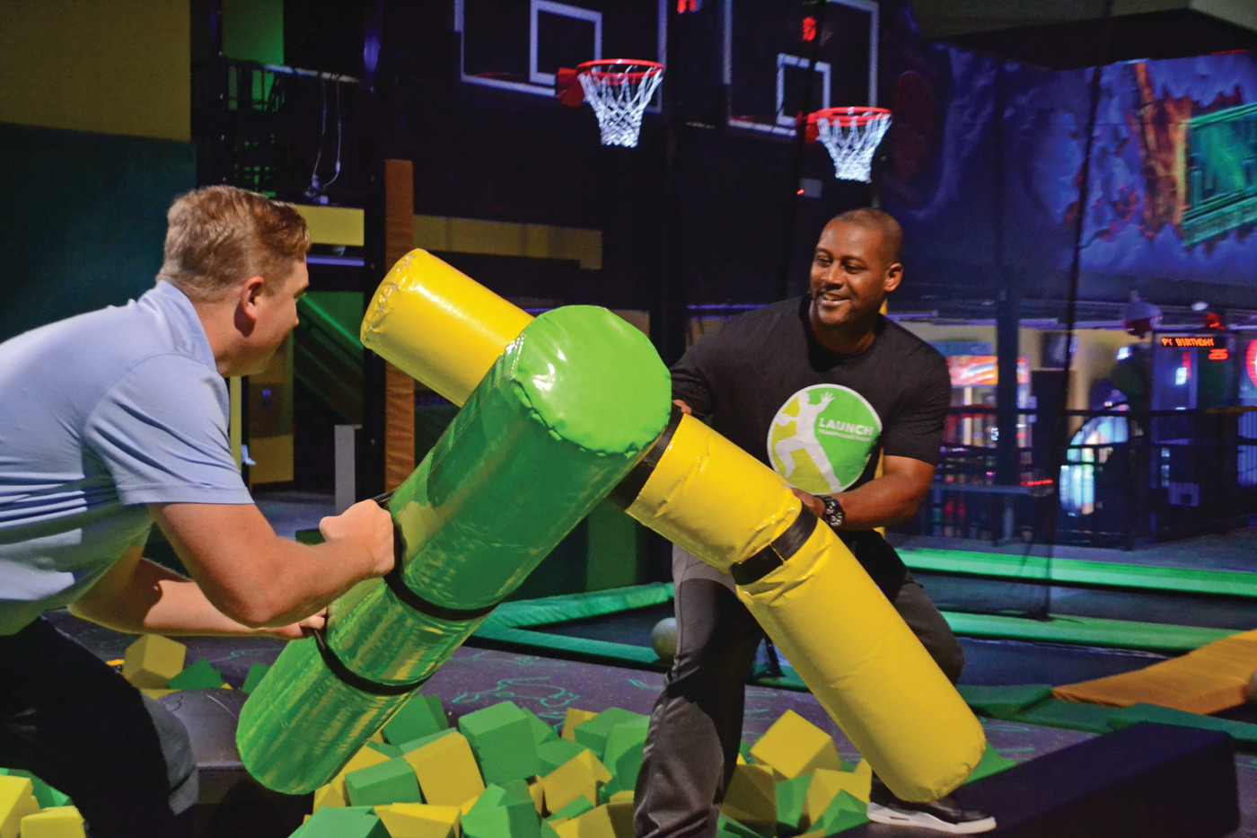 FRIENDLY COMPETITION: Launch owners Ty Law and Rob Arnold had a friendly sparring match with pillow batons over the top of a foam pit on Tuesday during an interview at the Warwick Launch Trampoline Park.