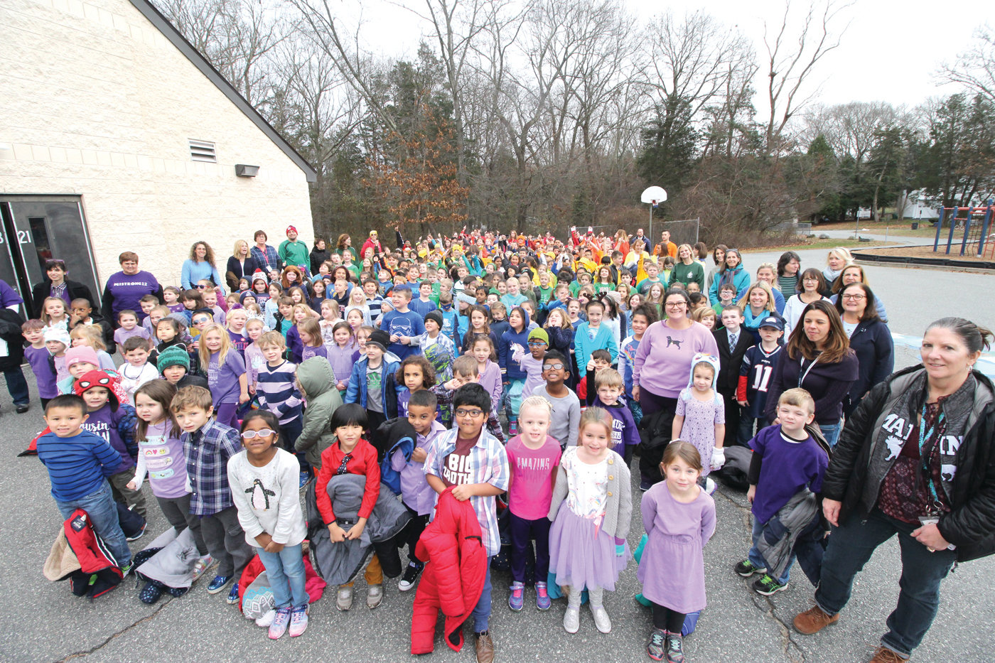 THE WHOLE SCHOOL: Cedar Hill School students and faculty gathered Friday for a group shot on the final day of spirit week. Excited ran high as everyone knew that Principal Dr. Frederick Schweizer would be the target of a Silly String attack moments later.