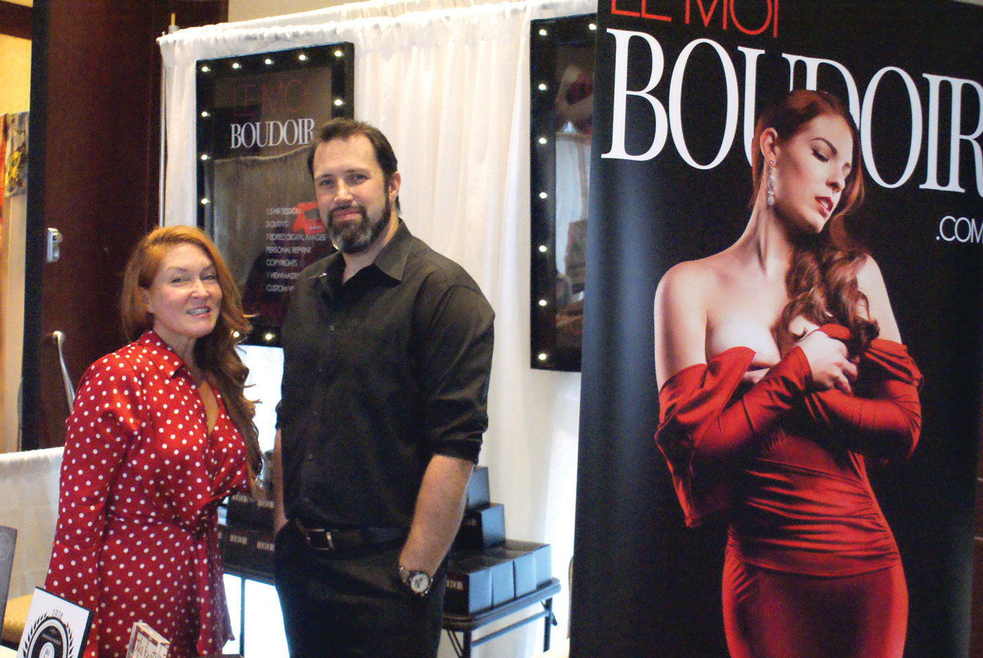 PHOTOGRAPHERS: Participating in the Rhode Island Women's Expo on Nov. 25 at the Crowne Plaza in Warwick were Michelle Carpenter (owner of Lemoi Boudoir Photographers located in Johnston) and her business partner Adam Clear.