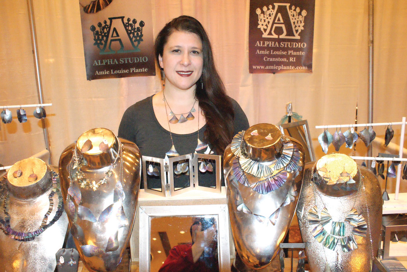 UNIQUE JEWLERY: At her display booth during the Rhode Island Women's Expo at the Crowne Plaza was Annie Louise Plante, Owner and Designer of fine art jewelry, Alpha Studio located in Cranston.