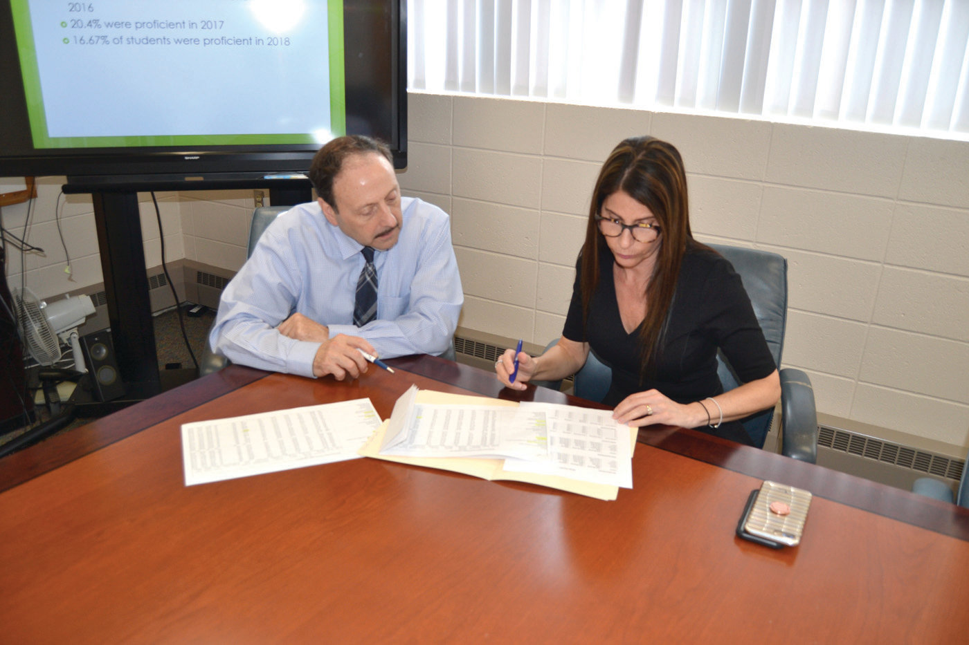 RUNNING THE NUMBERS:  Superintendent Dr. Bernard DiLullo Jr. and Assistant Superintendent Julie-anne Zarrella review RICAS test score results.  (Sun Rise photo)
