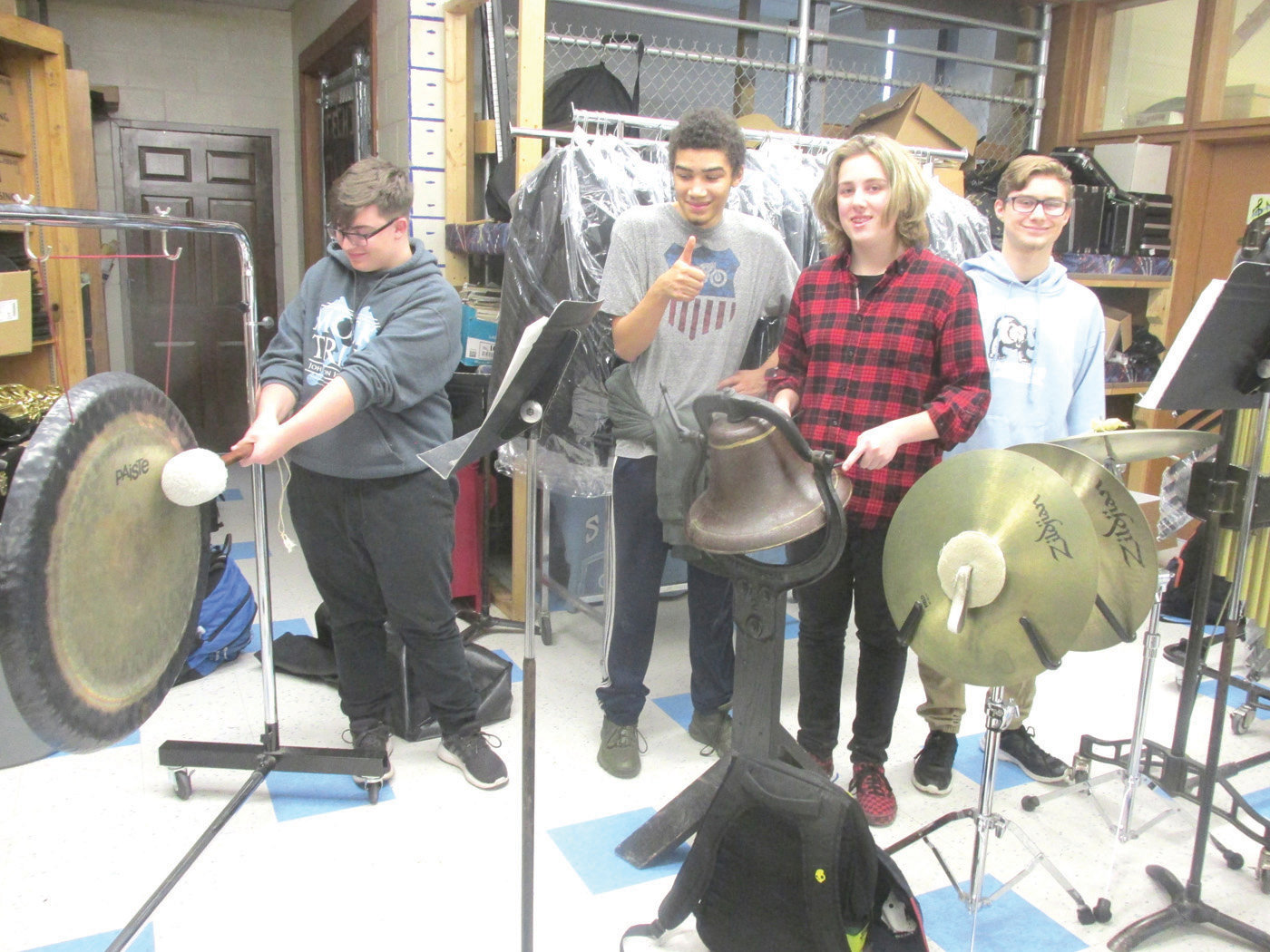 PERCUSSION PALS: Joseph Johnson will sound the gong, while Rafael River assists in another area during next Thursday night's Holiday Concert. Oliver Littlefield will use a borrowed antique ship's bell and the group also includes Jack Frenier. (Photos by Pete Fontaine)