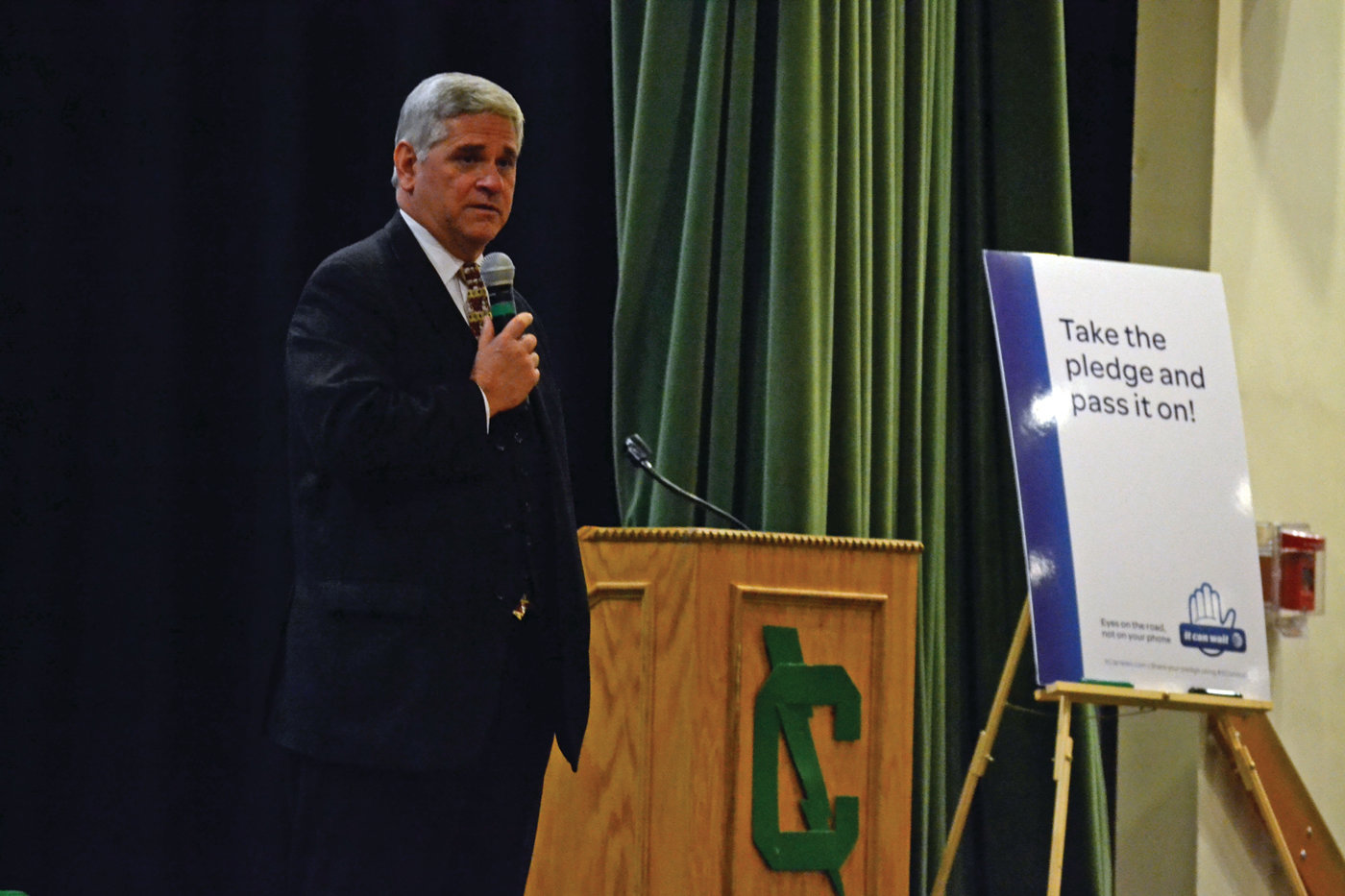 FULL CIRCLE: Attorney General Peter Kilmartin speaks to students at Cranston East as part of his 100th (and final) presentation of the It Can Wait program, which is a partnership between Rhode Island and AT&T.