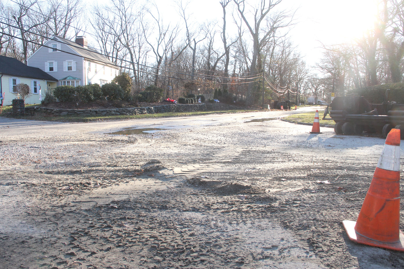GO SLOWLY: Uneven patches caused by sewer construction on Squantum Drive are to be leveled out shortly, according to Warwick Sewer Authority director Janine Burke-Wells. A final repaving is expected to take place after the project is completed in May of next year.