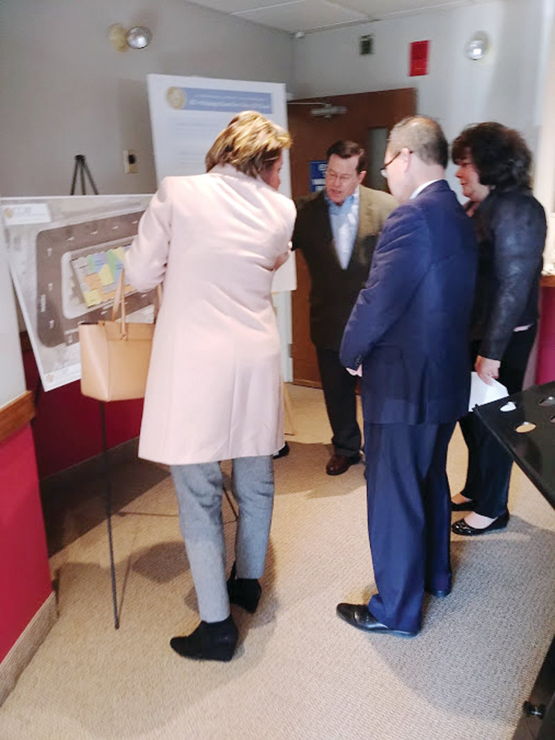 LOOKS LIKE A PLAN: City Councilwoman-elect, Lammis Vargis (Ward 1), Mayor Allan Fung, President Joanne McGonagle and CCAP's vice president of development and corporate affairs, Lee Beliveau, look over the plans for the new location.