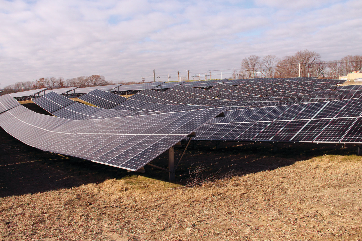 WHAT IT COULD BE: Southern Sky Renewal Energy built this solar farm on a brown field in Warwick. Some homeowners on Natick Avenue feel the company should be looking to develop similar sites in Cranston, not the wooded land under consideration.