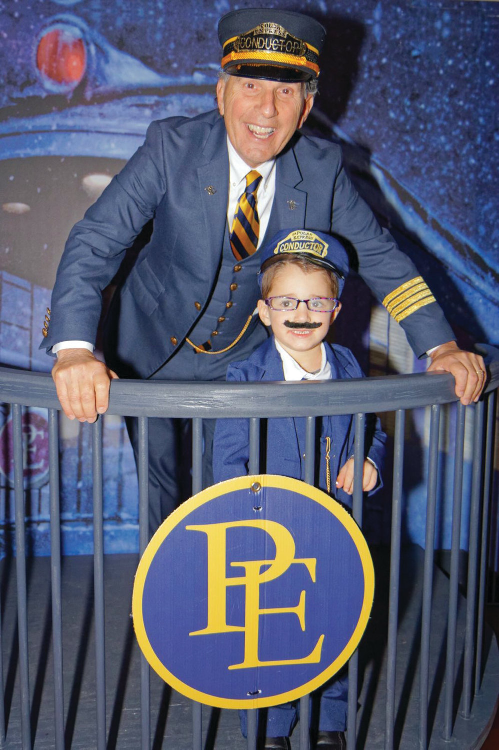 Conductor Robert Billington with a young traveler ready to experience the Polar Express.
