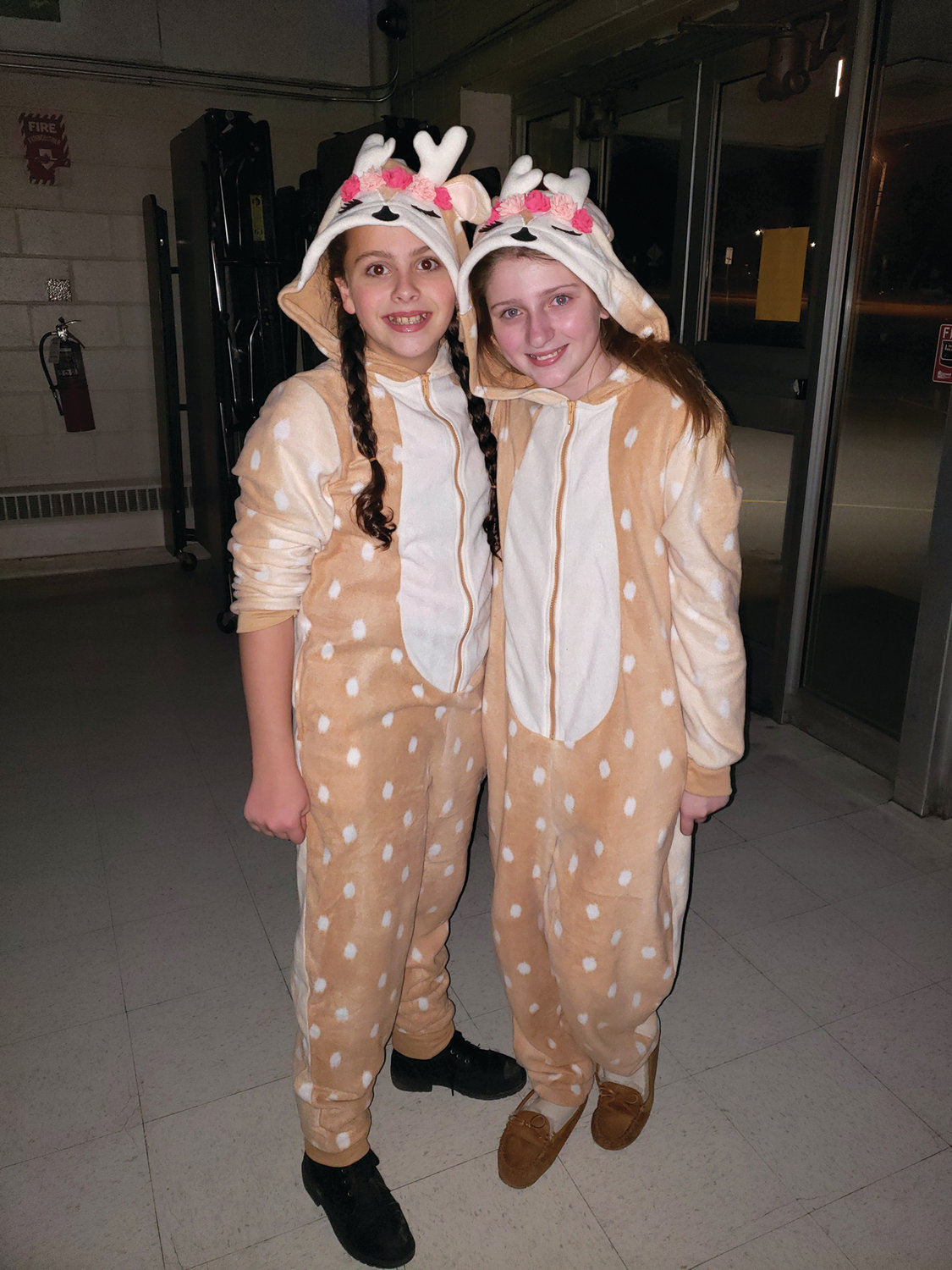 REINDEER GAMES: Kaylee Poole and Samantha Marcotte came dressed to impress for Ferri's Merry Mixer.