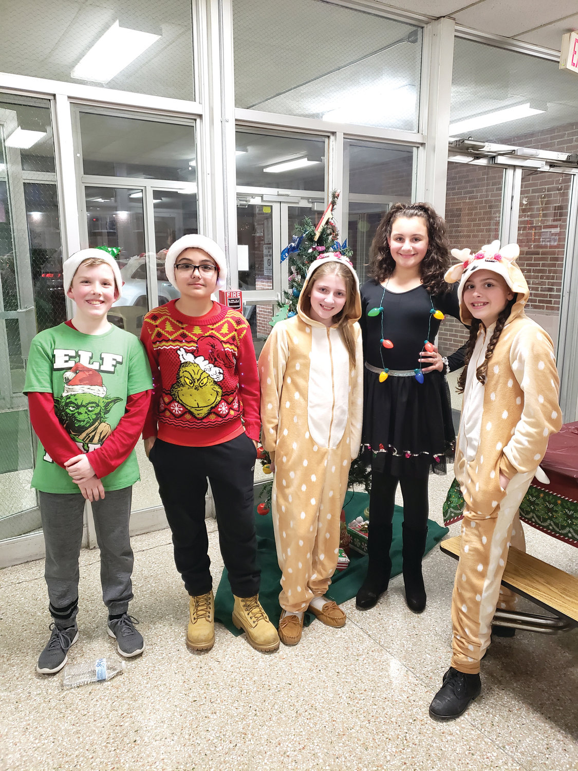 'TIS THE SEASON: Jacob Spence, Michael Pezza, Samantha Marcotte, Nicki Aucone and Kaylee Poole had a great time during last Friday's event.