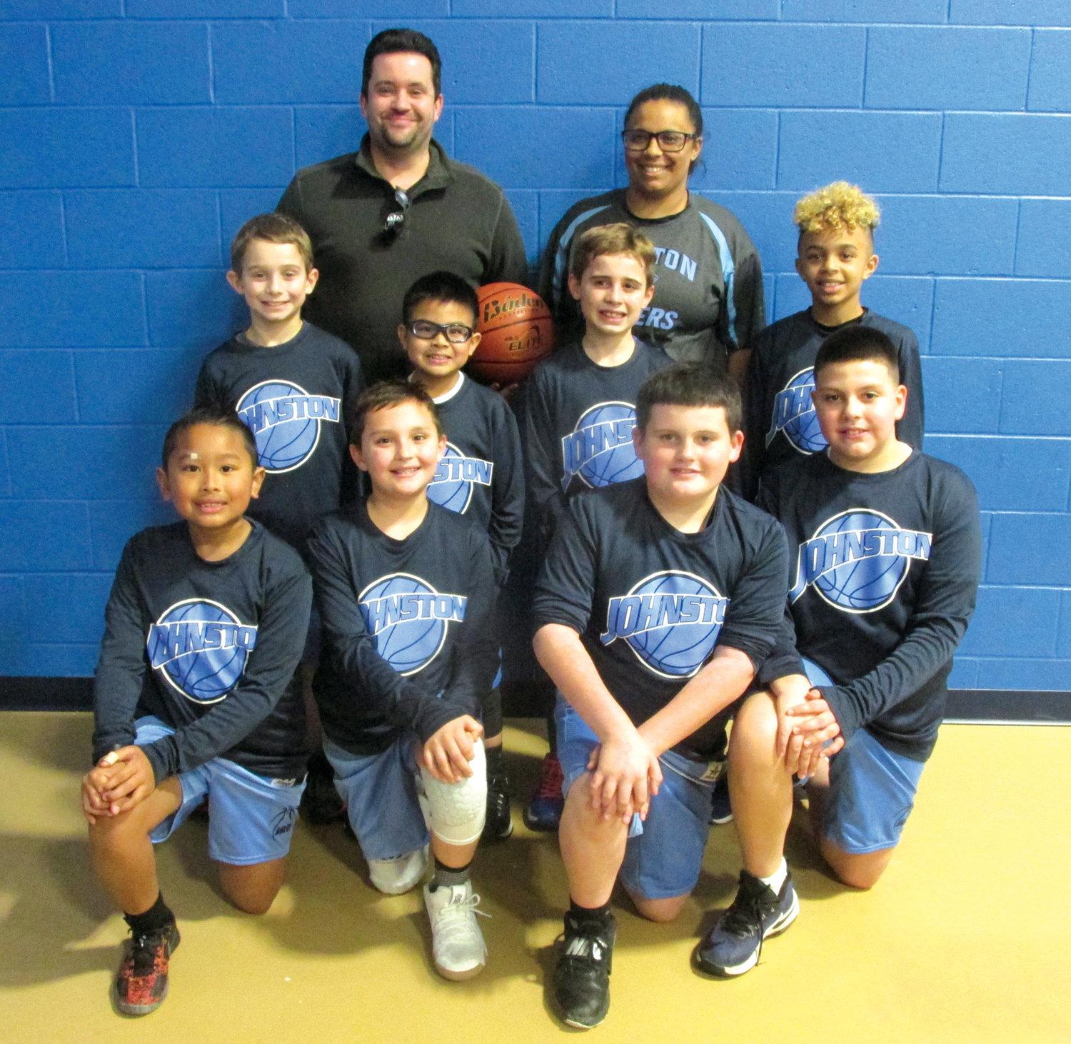 GIANNA'S GANG: Johnston's fourth grade level boys' team, which is coached by Gianna Mazzulla and her assistant Marc Waterman, includes in front row from left: Kaiden Kue, Ryan Waterman, Jay Spina and Michael Morsilli. Second row: Will Ferrara, Arthur Men, Logan Finelli and Jaziah Mazzulla.
