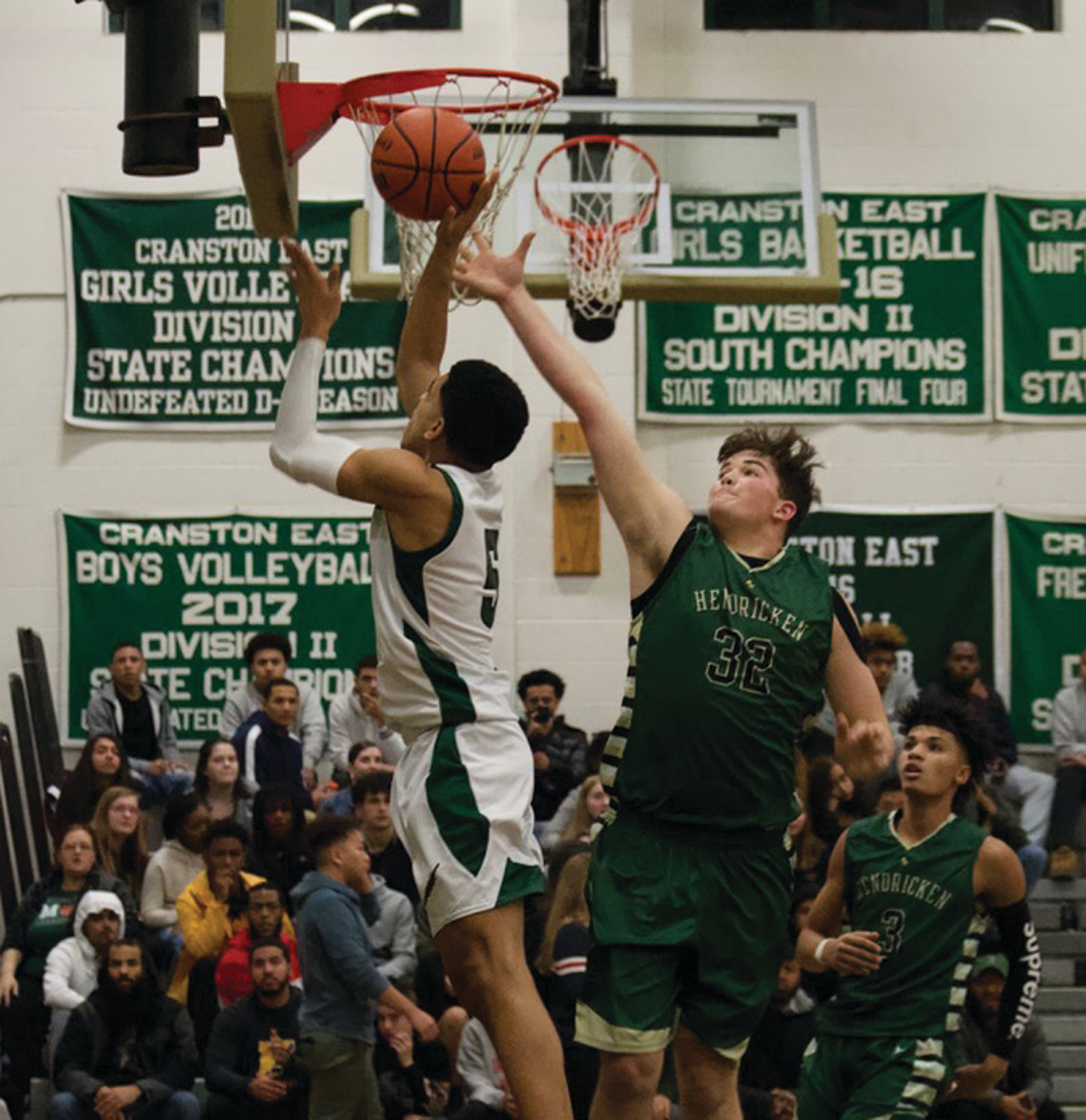 POSTING UP: Bishop Hendricken's Cameron Hughes goes to block a shot.
