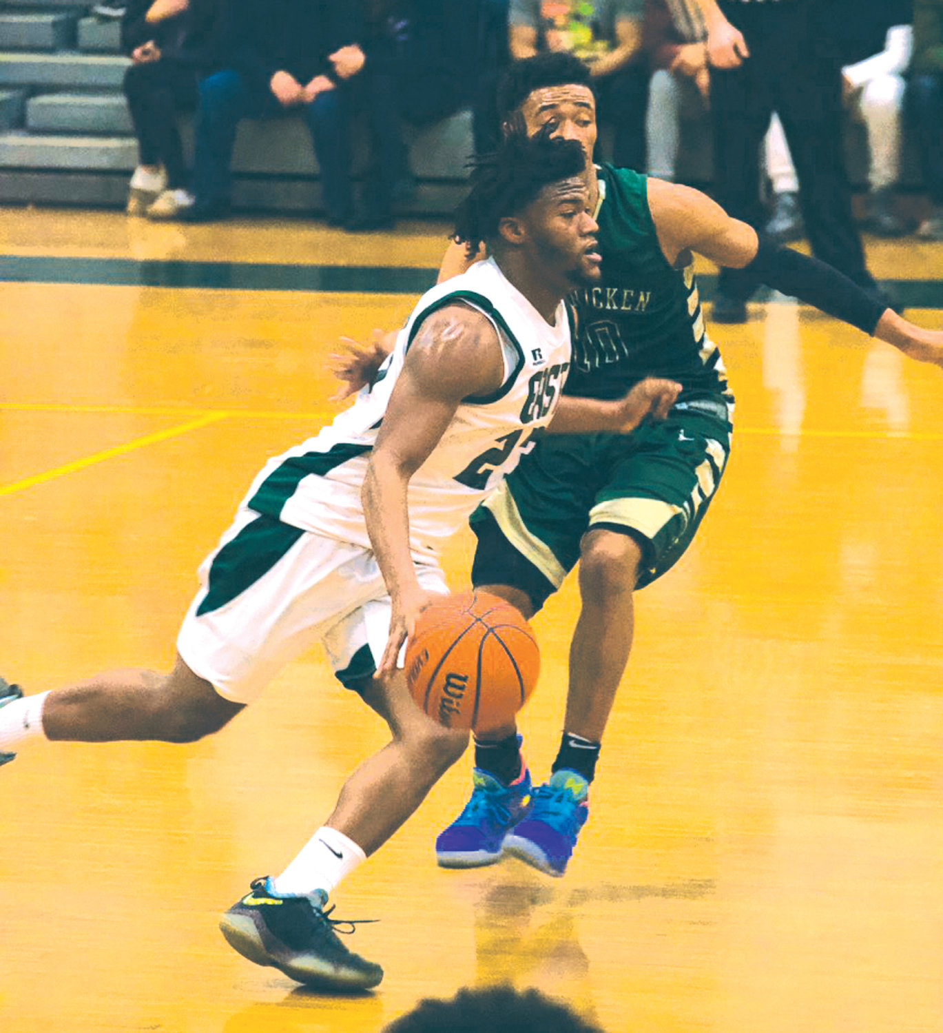 UP THE COURT: Cranston East's Aireus Raspberry works past a defender.