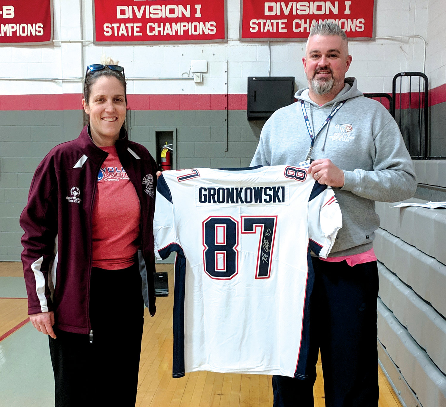 #NANCYSTRONG: Cranston Youth Girls Basketball Association Director and President PJ Thibodeau presents Cassie Rhodes a signed Rob Gronkowski jersey which she won in a raffle at the program's charity tournament.