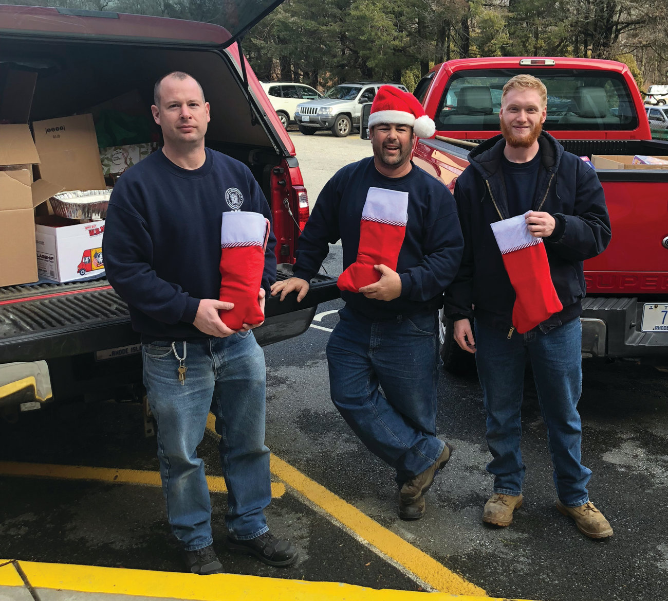 HELPING HANDS: These Johnston employees served as special Santa's helpers Monday to deliver the 80-plus gifts that Mayor Joseph Polisena's Elves collected during their annual Adopt-A-Family program.