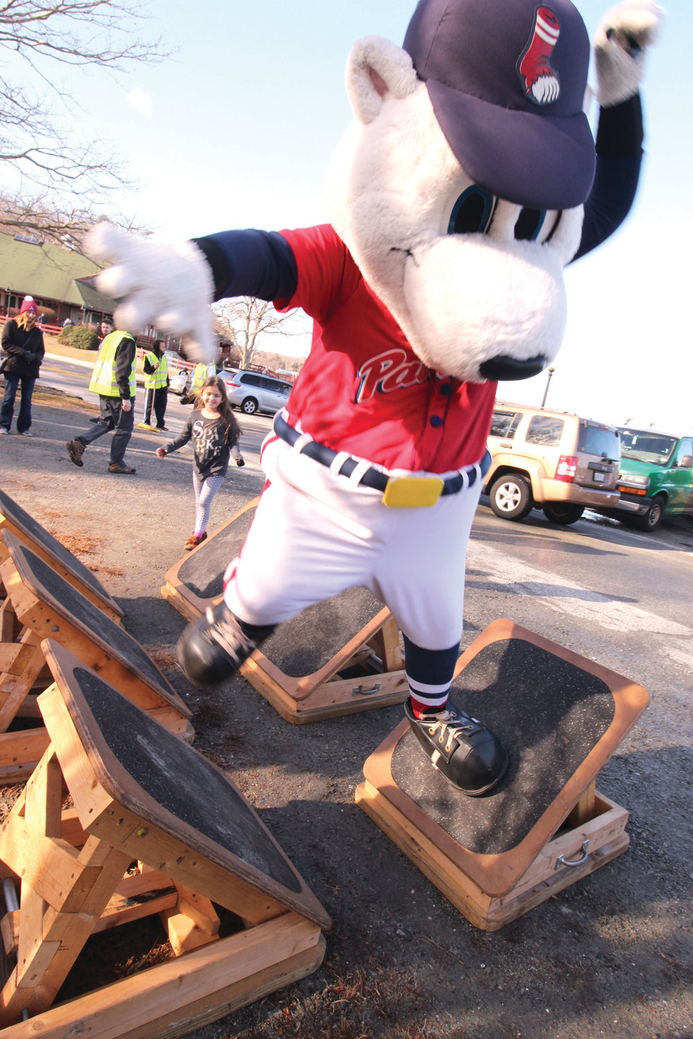 KEEPING HIS BALANCE: The PawSox mascot takes to the kiddie obsta course.