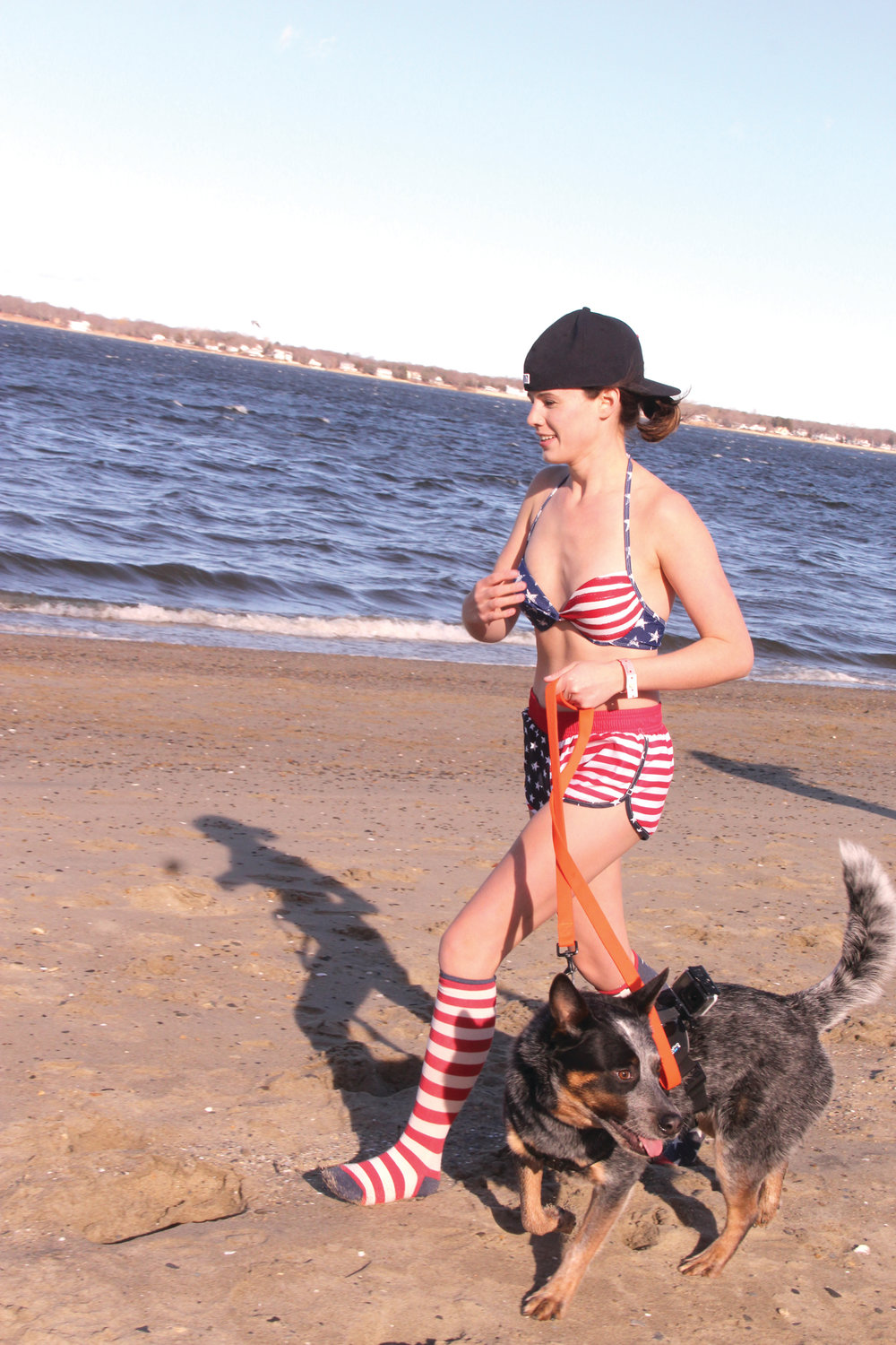 PATRIOTIC ATTIRE: One participant – we can't vouch for whether she went into the water - brought along company for the event.