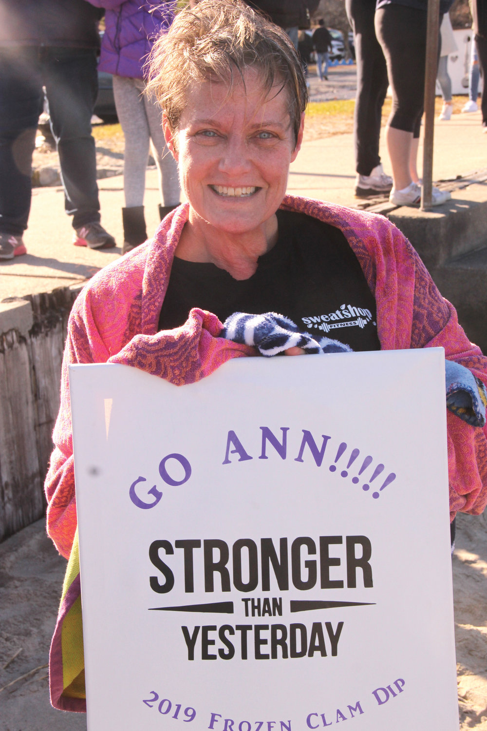 SIGN OF SUPPORT: Ann Altshuler who did the Obstaplunge displays the sign co-workers made for her.