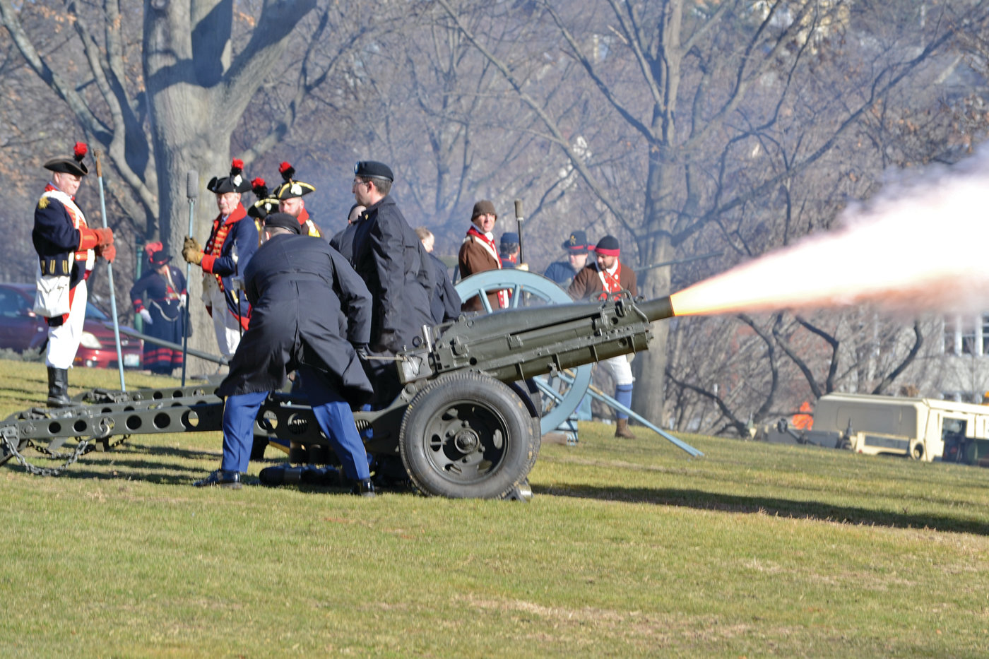 SHOTS VOLLEYED: A 19-gun salute fired off by the Rhode Island Militia and National Guard caused nearby car alarms to sound off, but provided excitement.