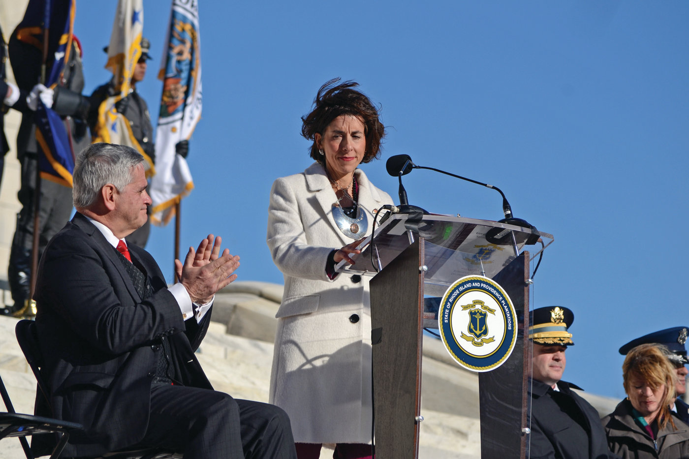 HOPE FOR THE FUTURE: Governor Gina Raimondo addresses the crowd as the strong winds gusted through Providence on Tuesday afternoon.