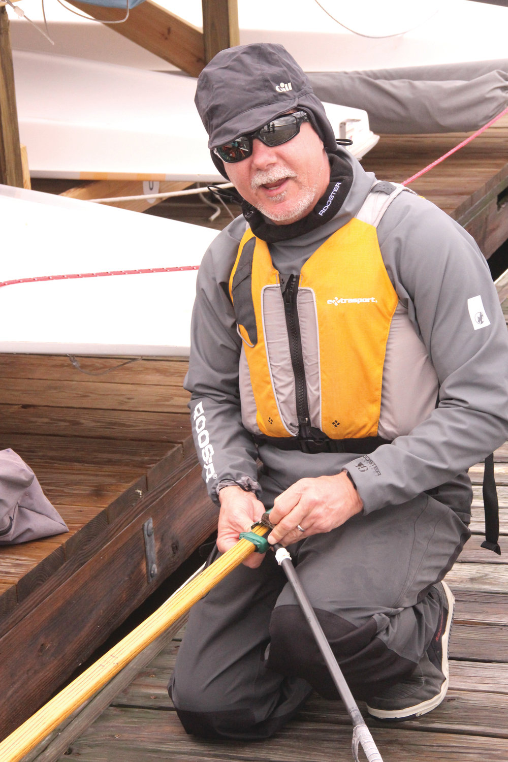DON'T WANT TO SCRATCH THE DECK: Chris lee tapes the hardware on his tiller so it won't scratch the boat. He regrets he didn't get around to doing it sooner.