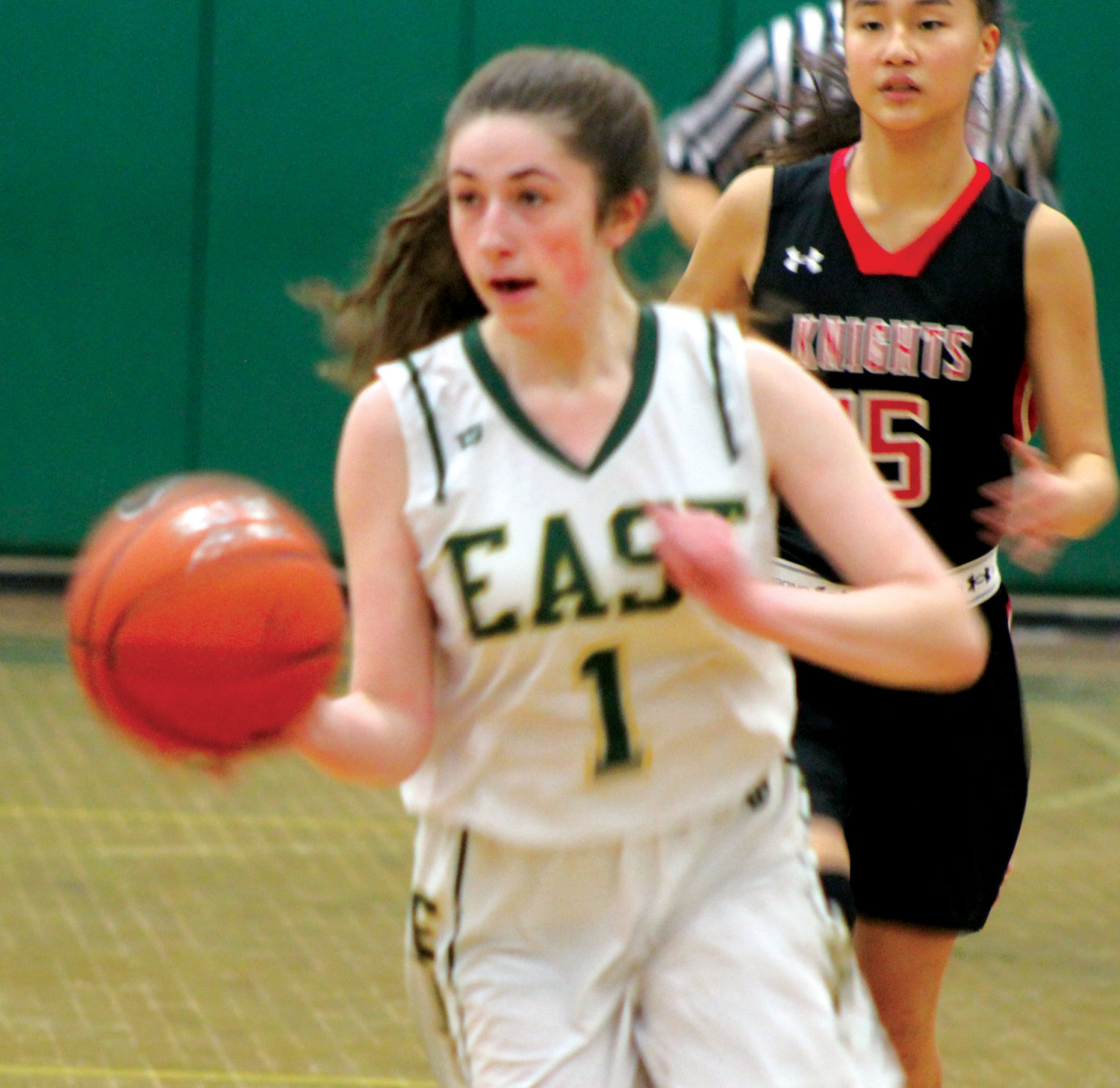 UP THE COURT: Cranston East's Kendra Dionizio dribbles up the court against PCD last week.