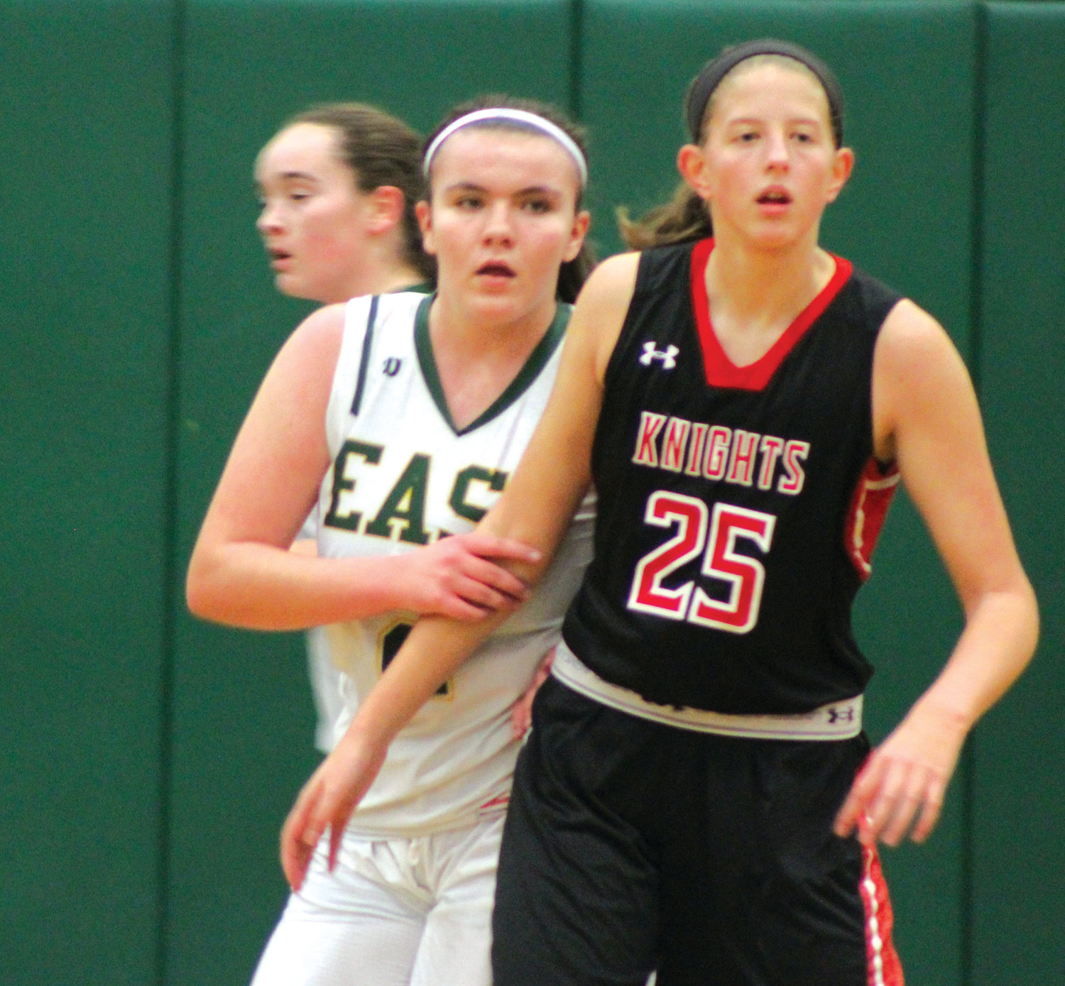 HOLIDAY BASKETBALL: Cranston East's Chloe Kitterick works past a PCD defender last week (above).