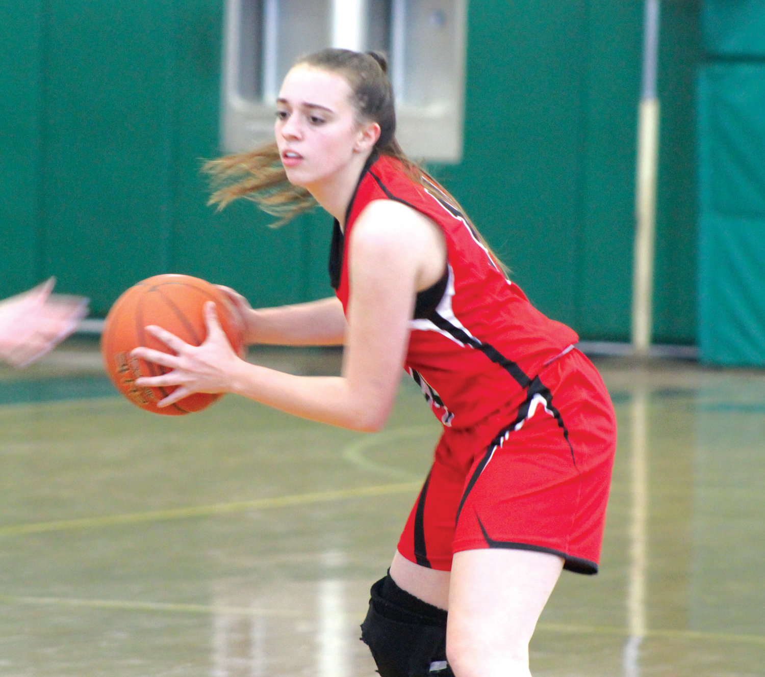A Cranston West guard looks for space to pass against Scituate last week during the team's tournament at Cranston East High School.