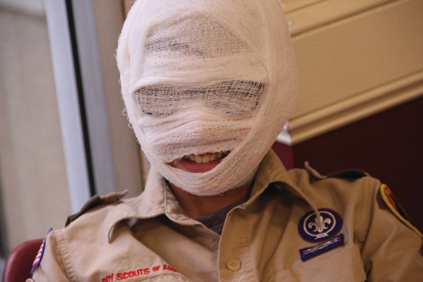 WRAPPED UP: One of the scouts in the first aid class (we couldn't identify him) couldn't resist using gauze for a cause