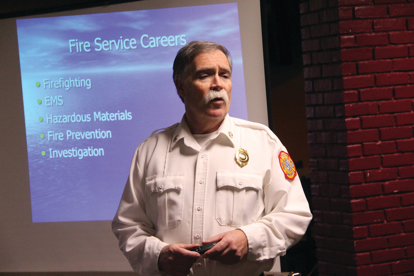 WHAT IT IS TO BE A FIREFIGHTER: Cranston Fire Chief William McKenna outlines career opportunities to scouts taking his class.