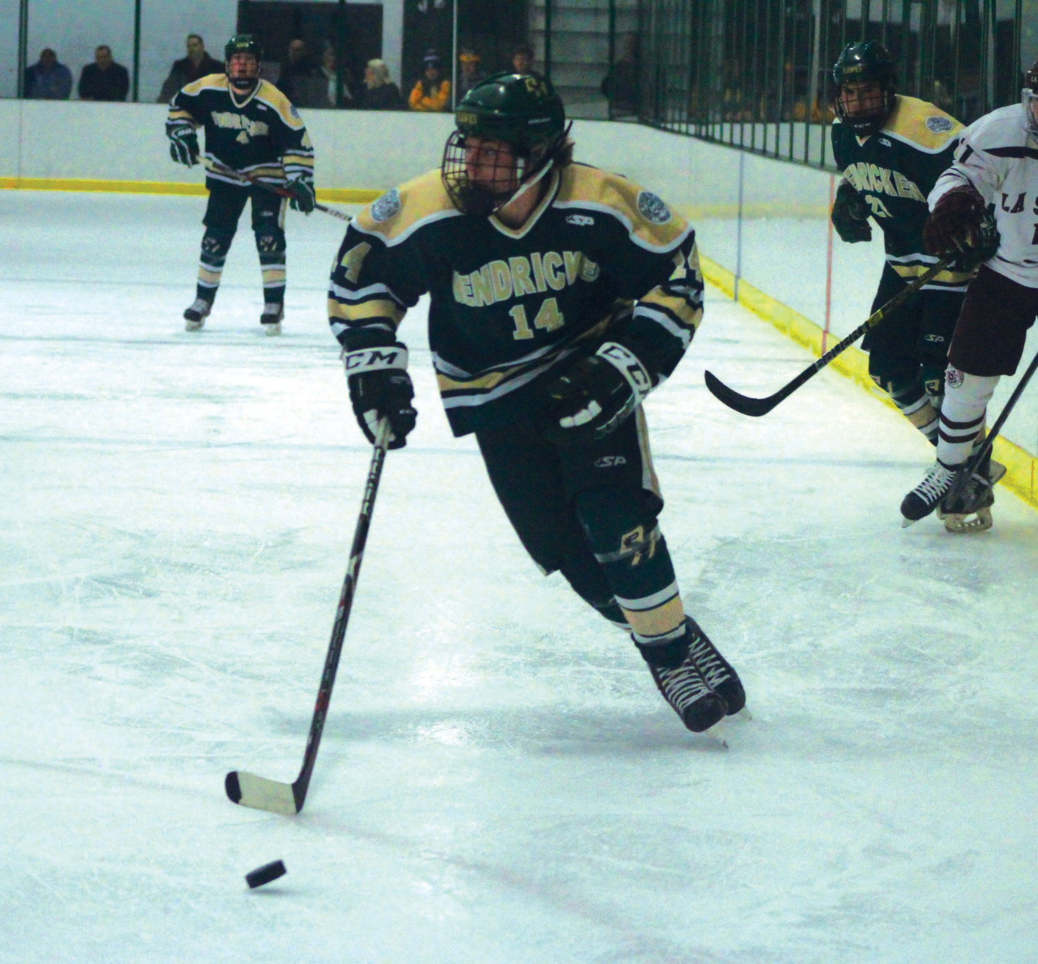 UP THE ICE: Bishop Hendricken's Jacob Tivey takes the puck up the ice.