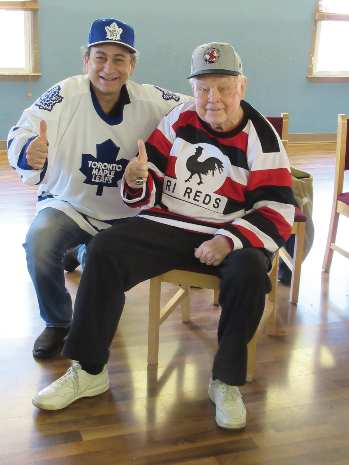 CRANSTON CORNER: Cranston resident Mike Mangasarian (left), new promoter of The 41st Super Bowl Weekend Show, is decked out in his old-time Toronto Maple Leafs garb as he joins legendary show founder Tom McDonough, now 80, who back in 1976 founded what developed into one of the longest running shows in the nation.