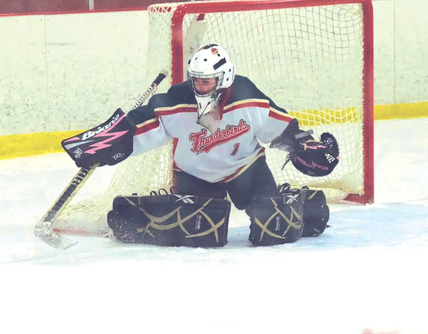HITTING THE ICE: Cranston/East Greenwich co-op goalie Hannah Slaiby makes a stop against South County last week.
