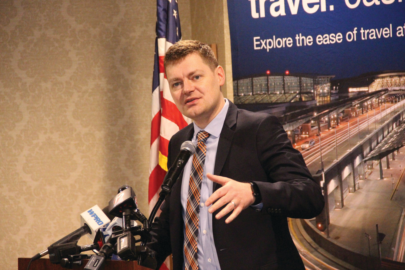 LANDING IN RHODE ISLAND: Brian Davis of Sun Country speaking at Tuesday's announcement.