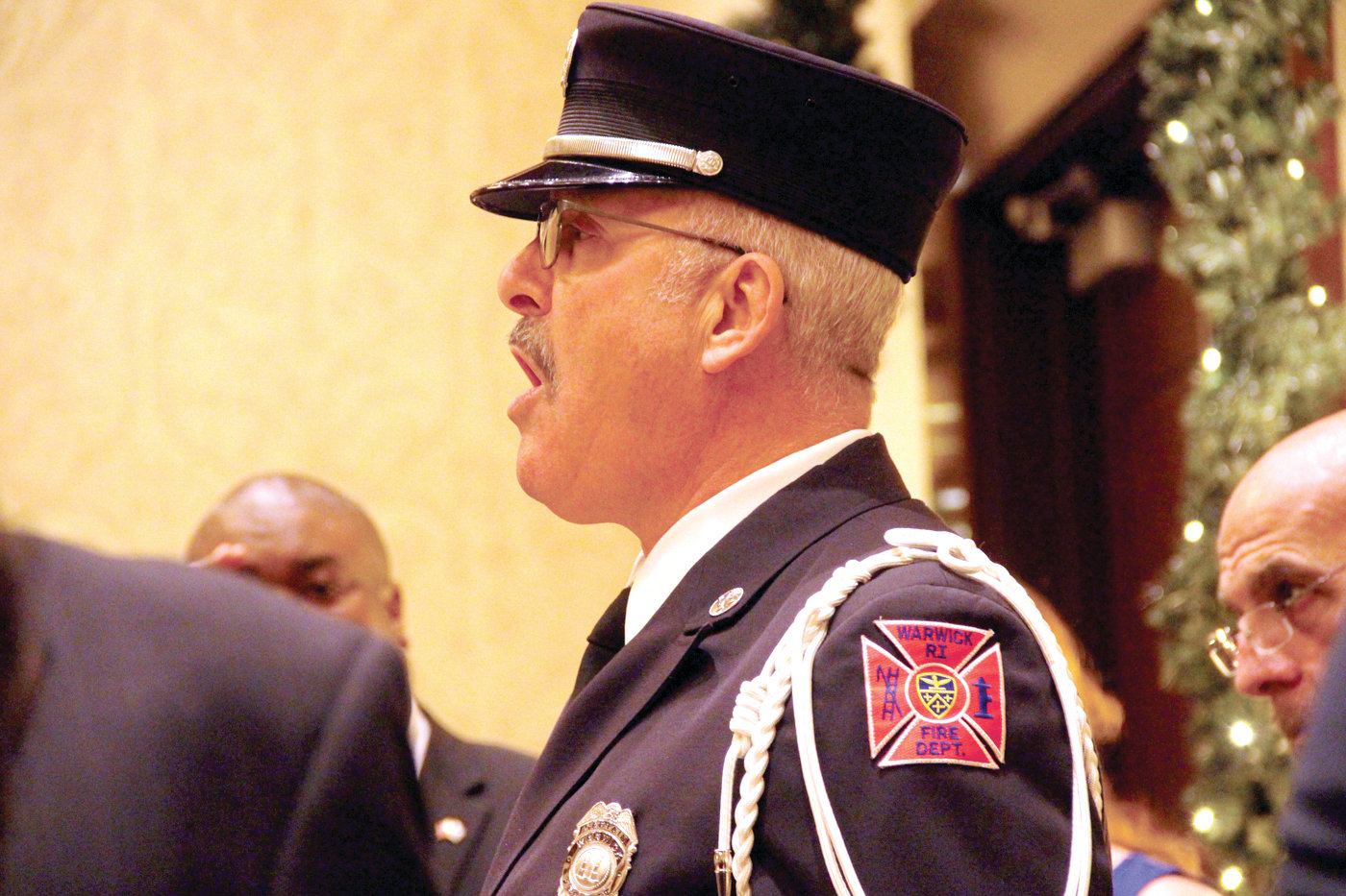 IT'S HIS GIG: Retired Warwick Fire Captain William Tyler, who is frequently called upon to sing the National Anthem, did so again at Tuesday's ceremony.