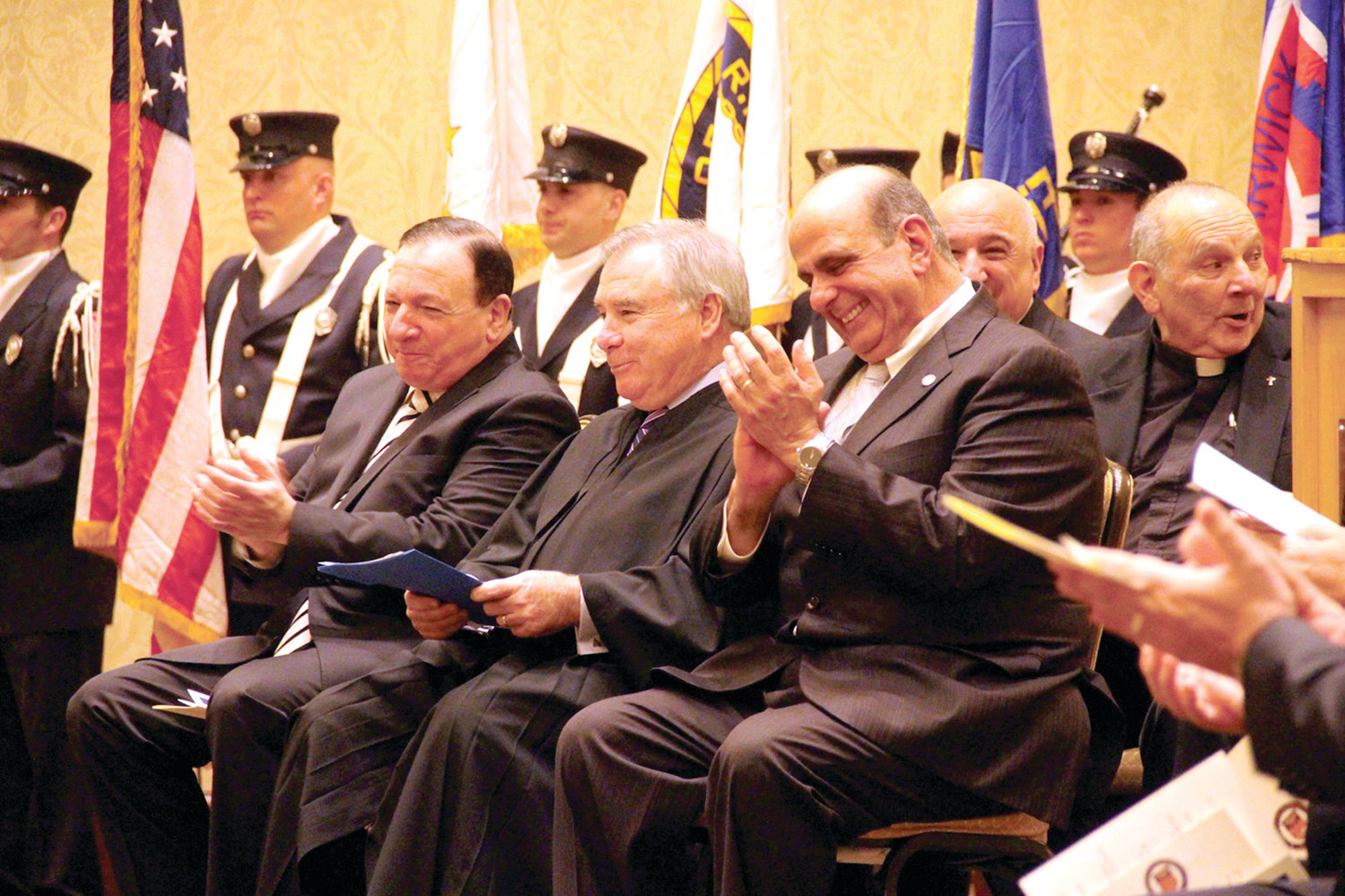 SHARING A LAUGH: While there was plenty of pageantry to the inauguration, there was also some humor as evidenced here as Michael Solomon, Associate Supreme Court Justice and former mayor Francis X. Flaherty and Mayor Joseph Solomon share a laugh.