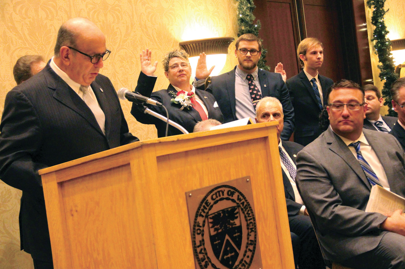 FIRST ORDER AS MAYOR: After taking office, Mayor Solomon administered the oath of office to the City Council followed by the three new members of the School Committee as seen here (from left) Judith Cobden, Kyle Adams and Nathaniel Cornell.