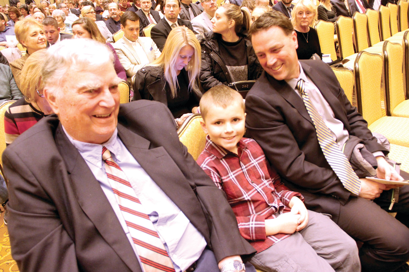 "CLAN DONOVAN: Former Mayor Charles Donovan with his grandson Matthew and son ""CJ"" got there early and sat up front."