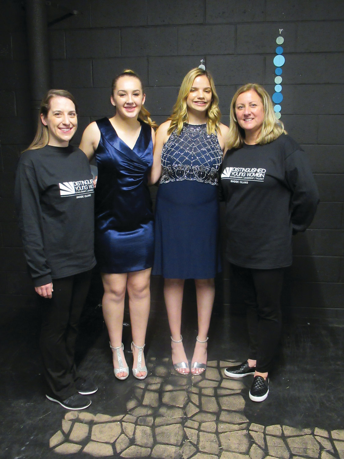 DISTINGUISHED DUO: Johnston High School students Kayleena-Leigh Lariviere (second left) and Ana Petrella (third left) are joined by Co-Chairpersons Katelyn Socha (left) and Susan Parillo during Sunday night's Distinguished Young Women state finals in Providence.